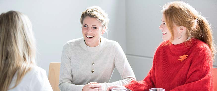 Two Popken Fashion Group employees smiling at the camera